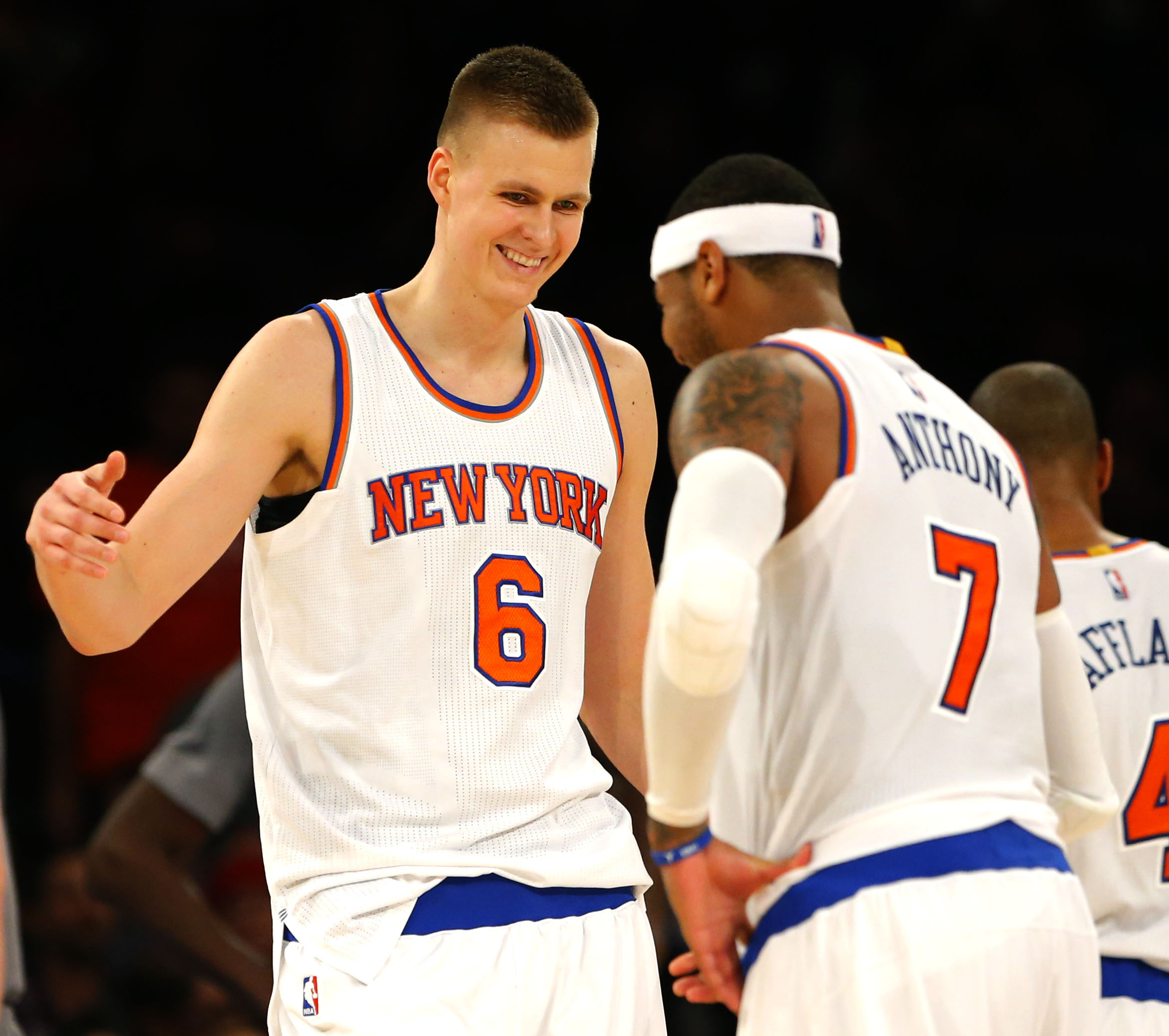 Dec 19, 2015; New York, NY, USA; New York Knicks forward Kristaps Porzingis (6) and New York Knicks forward Carmelo Anthony (7) react after a shot by Porzingis (6) during second half against the Chicago Bulls at Madison Square Garden. The New York Knicks defeated the Chicago Bulls 107-91. Mandatory Credit: Noah K. Murray-USA TODAY Sports
