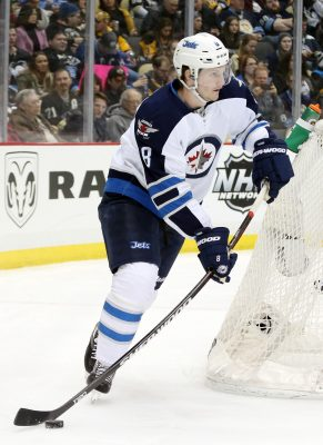 Feb 27, 2016; Pittsburgh, PA, USA; Winnipeg Jets defenseman Jacob Trouba (8) carries the puck from behind his net against the Pittsburgh Penguins during the second period at the CONSOL Energy Center. The Penguins won 4-1. Mandatory Credit: Charles LeClaire-USA TODAY Sports