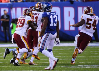 Sep 25, 2016; East Rutherford, NJ, USA; Washington Redskins players celebrate after a last minute interception in front of New York Giants wide receiver Odell Beckham (13) at MetLife Stadium. Mandatory Credit: Robert Deutsch-USA TODAY Sports