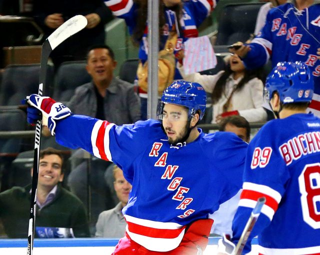 Sep 27, 2016; New York, NY, USA; New York Rangers center Mika Zibanejad (93) reacts after scoring a first period goal against the New York Islanders during a preseason hockey game at Madison Square Garden. Mandatory Credit: Andy Marlin-USA TODAY Sports