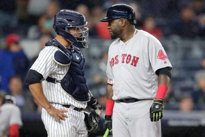 Sep 28, 2016; Bronx, NY, USA; New York Yankees catcher Gary Sanchez (24) talks to Boston Red Sox designated hitter David Ortiz (34) during the eighth inning at Yankee Stadium. Ortiz was intentionally walked in the at-bat. Mandatory Credit: Brad Penner-USA TODAY Sports