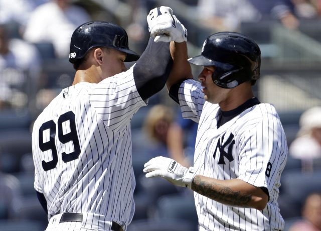 Aug 17, 2016; Bronx, NY, USA; New York Yankees designated hitter Gary Sanchez (24) celebrates hitting a solo home run against the Toronto Blue Jays with Aaron Judge (99) during the second inning at Yankee Stadium. Mandatory Credit: Adam Hunger-USA TODAY Sports