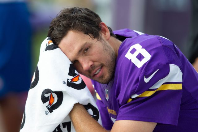 Sep 25, 2016; Charlotte, NC, USA; Minnesota Vikings quarterback Sam Bradford (8) sits on the bench in the fourth quarter against the Carolina Panthers at Bank of America Stadium. The Vikings defeated the Panthers 22-10. Mandatory Credit: Jeremy Brevard-USA TODAY Sports