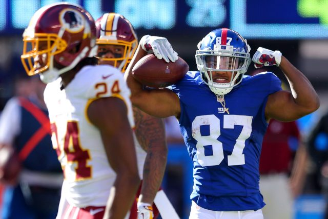 Sep 25, 2016; East Rutherford, NJ, USA; New York Giants wide receiver Sterling Shepard (87) reacts after being hit by Washington Redskins corner back Josh Norman (24) during the fourth quarter at MetLife Stadium. Mandatory Credit: Brad Penner-USA TODAY Sports