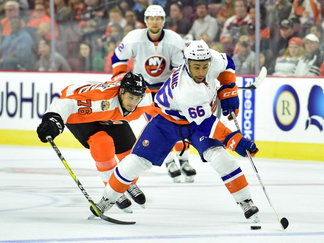 Sep 27, 2016; Philadelphia, PA, USA; New York Islanders right wing Josh Ho-Sang (66) carries the puck past Philadelphia Flyers center Chris VandeVelde (76) during the second period during a preseason hockey game at Wells Fargo Center. Mandatory Credit: Eric Hartline-USA TODAY Sports
