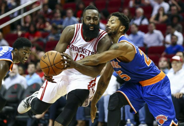 Oct 4, 2016; Houston, TX, USA; New York Knicks guard Derrick Rose (25) attempts to steal the ball from Houston Rockets guard James Harden (13) during the second quarter at Toyota Center. Mandatory Credit: Troy Taormina-USA TODAY Sports