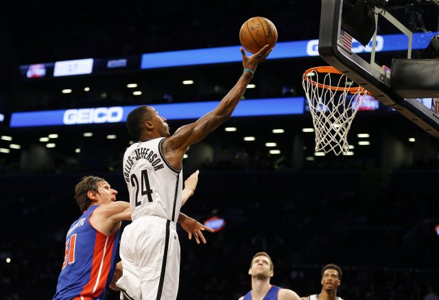 Oct 6, 2016; Brooklyn, NY, USA; Brooklyn Nets forward Rondae Hollis-Jefferson (24) goes up for a shot while being defended by Detroit Pistons center Boban Marjanovic (51) during the second half at Barclays Center. The Nets won 101-94. Mandatory Credit: Andy Marlin-USA TODAY Sports