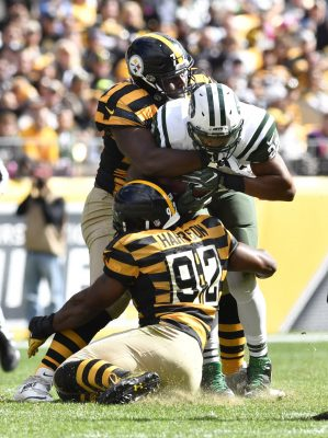 Oct 9, 2016; Pittsburgh, PA, USA; New York Jets running back Matt Forte (22) is tackled by Pittsburgh Steelers outside linebacker James Harrison (92) and nose tackle Javon Hargrave (79) during the second quarter at Heinz Field against the New York Jets. Mandatory Credit: Mark Konezny-USA TODAY Sports
