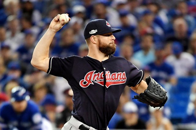 Oct 18, 2016; Toronto, Ontario, CAN; Cleveland Indians starting pitcher Corey Kluber (28) throws a pitch during the first inning against the Toronto Blue Jays in game four of the 2016 ALCS playoff baseball series at Rogers Centre. Mandatory Credit: Nick Turchiaro-USA TODAY Sports