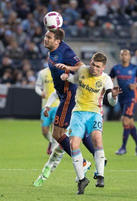 Oct 23, 2016; New York, NY, USA;  New York City FC midfielder Frank Lampard (8) heads a ball over Columbus Crew midfielder Will Trapp (20) during the second half at Yankee Stadium. New York City FC won 4-1.  Mandatory Credit: Vincent Carchietta-USA TODAY Sports
