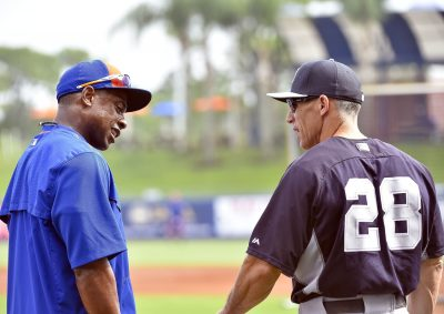 Mar 22, 2015; Port St. Lucie, FL, USA; New York Mets right fielder Curtis Granderson (3) talks with New York Yankees manager Joe Girardi (28) before the game at Tradition Field. Mandatory Credit: Scott Rovak-USA TODAY Sports
