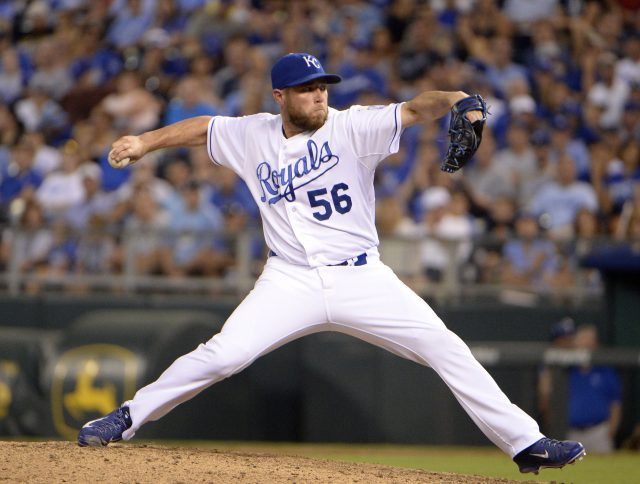Aug 14, 2015; Kansas City, MO, USA; Kansas City Royals relief pitcher Greg Holland (56) delivers a pitch against the Los Angeles Angels in the ninth inning at Kauffman Stadium. Kansas City won the game 4-1. Mandatory Credit: John Rieger-USA TODAY Sports