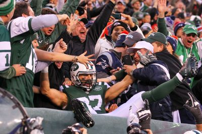 Dec 27, 2015; East Rutherford, NJ, USA; New York Jets wide receiver Eric Decker (87) celebrates his game winning touchdown pass from New York Jets quarterback Ryan Fitzpatrick (14) (not shown) during overtime at MetLife Stadium. The Jets defeated the Patriots 26-20. Mandatory Credit: Ed Mulholland-USA TODAY Sports