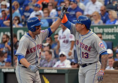 Apr 5, 2016; Kansas City, MO, USA; New York Mets second baseman Neil Walker (20) is congratulated by shortstop Asdrubal Cabrera (13) after Walker hits a two run home run in the fourth inning against the Kansas City Royals at Kauffman Stadium. Mandatory Credit: Denny Medley-USA TODAY Sports