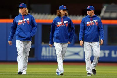 May 20, 2016; New York City, NY, USA; New York Mets starting pitcher Noah Syndergaard (34) and New York Mets starting pitcher Jacob deGrom (48) and New York Mets starting pitcher Matt Harvey (33) walk in from the bullpen before the first inning against the Milwaukee Brewers at Citi Field. Mandatory Credit: Brad Penner-USA TODAY Sports