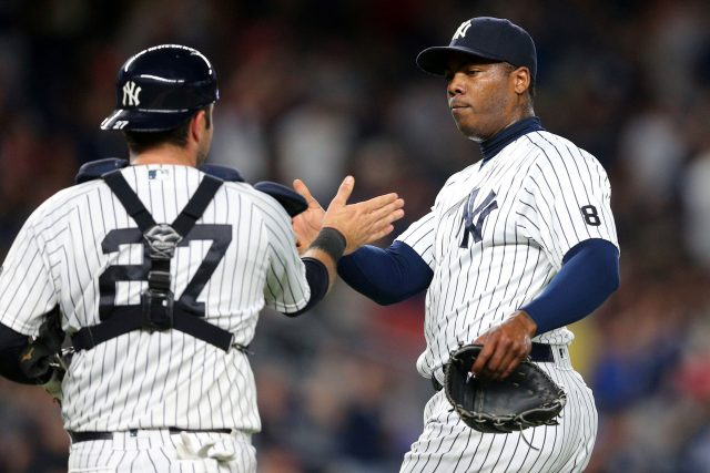 Jul 17, 2016; Bronx, NY, USA; New York Yankees relief pitcher Aroldis Chapman (54) and catcher Austin Romine (27) celebrate after defeating the Boston Red Sox at Yankee Stadium. Mandatory Credit: Brad Penner-USA TODAY Sports