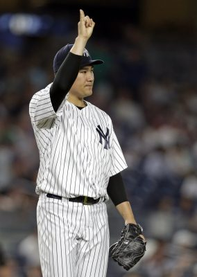 Jul 22, 2016; Bronx, NY, USA; New York Yankees starting pitcher Masahiro Tanaka (19) reacts during the sixth inning of an inter-league baseball game against the San Francisco Giants at Yankee Stadium. Mandatory Credit: Adam Hunger-USA TODAY Sports