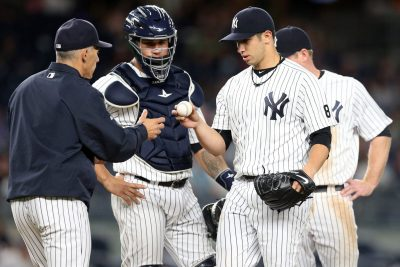 Sep 6, 2016; Bronx, NY, USA; New York Yankees starting pitcher Luis Cessa (85) hands the ball to New York Yankees manager Joe Girardi (28) after being removed from the game again the Toronto Blue Jays during the sixth inning at Yankee Stadium. Mandatory Credit: Brad Penner-USA TODAY Sports