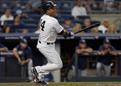 Sep 9, 2016; Bronx, NY, USA; New York Yankees second baseman Starlin Castro (14) hits a single during the first inning against the Tampa Bay Rays at Yankee Stadium. Mandatory Credit: Adam Hunger-USA TODAY Sports