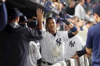 Sep 12, 2016; Bronx, NY, USA; New York Yankees second baseman Starlin Castro (14) is congratulated in the dugout after hitting a solo home run against the Los Angeles Dodgers during the second inning at Yankee Stadium. Mandatory Credit: Brad Penner-USA TODAY Sports