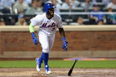 Sep 20, 2016; New York City, NY, USA; New York Mets third baseman Jose Reyes (7) hits a triple against the Atlanta Braves during the third inning at Citi Field. Mandatory Credit: Brad Penner-USA TODAY Sports