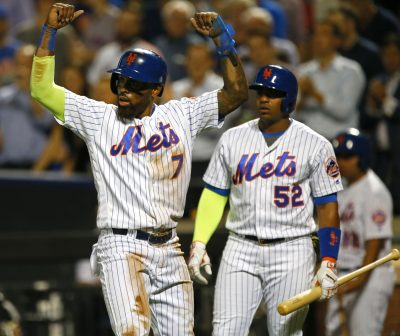 Sep 21, 2016; New York City, NY, USA; New York Mets third baseman Jose Reyes (7) reacts after scoring on a home run by New York Mets shortstop Asdrubal Cabrera (13) (not pictured) in the first inning against the Atlanta Braves at Citi Field. Mandatory Credit: Noah K. Murray-USA TODAY Sports