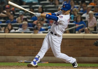 Sep 23, 2016; New York City, NY, USA; New York Mets left fielder Michael Conforto (30) hits a three RBI home run against the Philadelphia Phillies during the fifth inning at Citi Field. Mandatory Credit: Bill Streicher-USA TODAY Sports