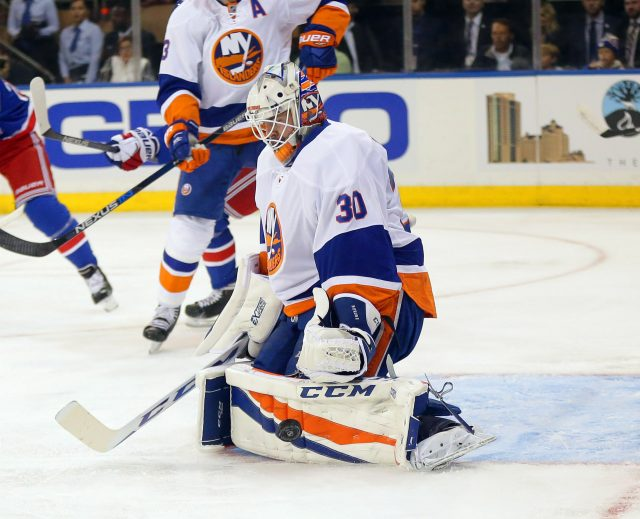 Sep 27, 2016; New York, NY, USA; New York Islanders goaltender JF Berube (30) makes a pad save against the New York Rangers during the first period during a preseason hockey game at Madison Square Garden. Mandatory Credit: Andy Marlin-USA TODAY Sports