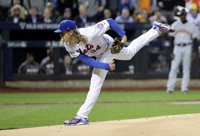 Oct 5, 2016; New York City, NY, USA; New York Mets starting pitcher Noah Syndergaard (34) throws during the first inning against the San Francisco Giants in the National League wild card playoff baseball game at Citi Field. Mandatory Credit: Anthony Gruppuso-USA TODAY Sports