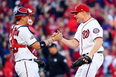 Oct 9, 2016; Washington, DC, USA; Washington Nationals relief pitcher Mark Melancon (43) celebrates with catcher Jose Lobaton (L) after their win against the Los Angeles Dodgers during game two of the 2016 NLDS playoff baseball series at Nationals Park. The Washington Nationals won 5-2.Mandatory Credit: Brad Mills-USA TODAY Sports