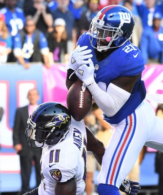 Oct 16, 2016; East Rutherford, NJ, USA; New York Giants strong safety Landon Collins (21) breaks up a 4th quarter pass attempt to Baltimore Ravens wide receiver Kamar Aiken (11) at MetLife Stadium. Mandatory Credit: Robert Deutsch-USA TODAY Sports