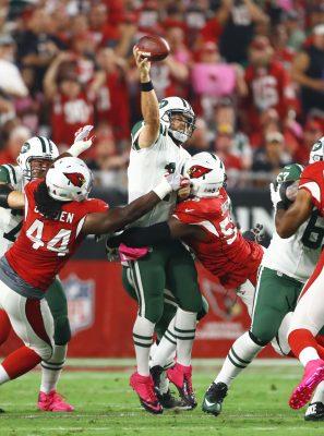 Oct 17, 2016; Glendale, AZ, USA; New York Jets quarterback Ryan Fitzpatrick (14) throws the ball as he is hit by Arizona Cardinals linebacker Chandler Jones (55) in the first quarter at University of Phoenix Stadium. Mandatory Credit: Mark J. Rebilas-USA TODAY Sports