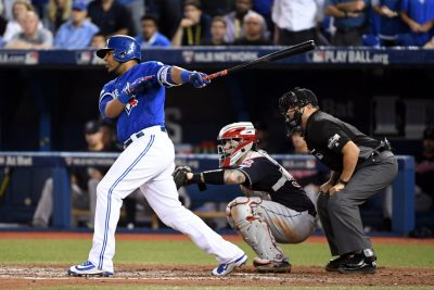 Oct 18, 2016; Toronto, Ontario, CAN; Toronto Blue Jays first baseman Edwin Encarnacion (10) hits an two RBI single during the seventh inning against the Cleveland Indians in game four of the 2016 ALCS playoff baseball series at Rogers Centre. Mandatory Credit: Nick Turchiaro-USA TODAY Sports