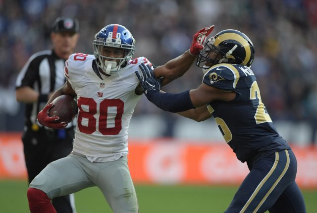 Oct 23, 2016; London, United Kingdom; New York Giants receiver Victor Cruz (80) is defended by Los Angeles Rams strong safety T.J. McDonald (25) on a 25-yard reception during game 16 of the NFL International Series at Twickenham Stadium. Mandatory Credit: Kirby Lee-USA TODAY Sports