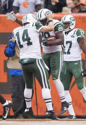 Oct 30, 2016; Cleveland, OH, USA; New York Jets quarterback Ryan Fitzpatrick (14) celebrates running back Bilal Powell (29) touchdown during the second quarter against the Cleveland Browns at FirstEnergy Stadium. Mandatory Credit: Scott R. Galvin-USA TODAY Sports