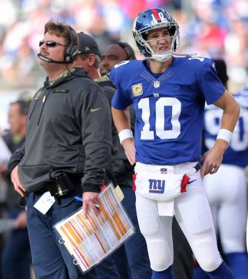 Nov 6, 2016; East Rutherford, NJ, USA; New York Giants quarterback Eli Manning (10) and New York Giants head coach Ben McAdoo watch from the sidelines during the second quarter against the Philadelphia Eagles at MetLife Stadium. Mandatory Credit: Brad Penner-USA TODAY Sports