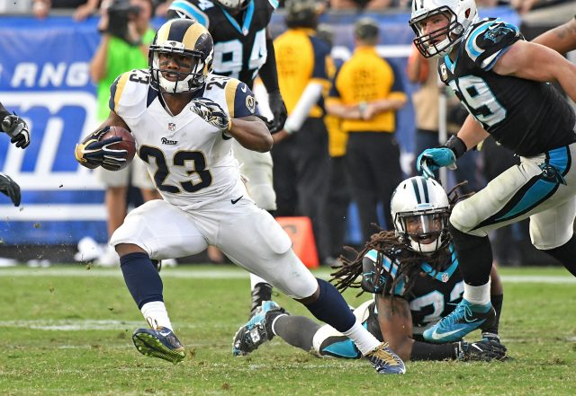 Nov 6, 2016; Los Angeles, CA, USA; Los Angeles Rams running back Benny Cunningham (23) carries the ball past Carolina Panthers free safety Tre Boston (33) in the second half of the game at the Los Angeles Memorial Coliseum. Mandatory Credit: Jayne Kamin-Oncea-USA TODAY Sports