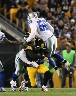 Nov 13, 2016; Pittsburgh, PA, USA; Pittsburgh Steelers quarterback Ben Roethlisberger (7) is hit from behind and from Dallas Cowboys linebacker Justin Durant (56) as he throws a pass against the Dallas Cowboys during the first half of their game at Heinz Field. Mandatory Credit: Jason Bridge-USA TODAY Sports