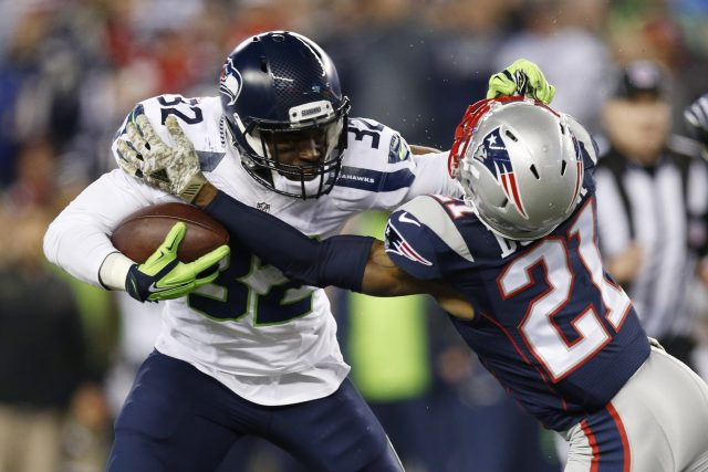 Nov 13, 2016; Foxborough, MA, USA;  Seattle Seahawks running back Christine Michael (32) is tackled by New England Patriots cornerback Malcolm Butler (21) during the fourth quarter at Gillette Stadium.  The Seattle Seahawks won 31-24.  Mandatory Credit: Greg M. Cooper-USA TODAY Sports