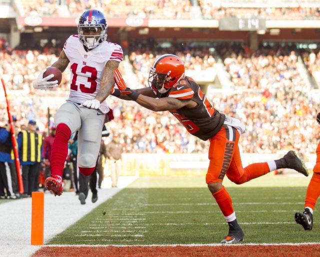 Nov 27, 2016; Cleveland, OH, USA; New York Giants wide receiver Odell Beckham (13) gets hit by Cleveland Browns defensive back Marcus Burley (26) as he runs the ball into the endzone for a touchdown during the second quarter at FirstEnergy Stadium. Mandatory Credit: Scott R. Galvin-USA TODAY Sports