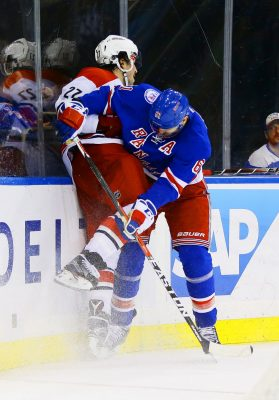 Nov 29, 2016; New York, NY, USA; New York Rangers right wing Rick Nash (61) and Carolina Hurricanes defenseman Justin Faulk (27) come together at the boards during the second period at Madison Square Garden. Mandatory Credit: Andy Marlin-USA TODAY Sports