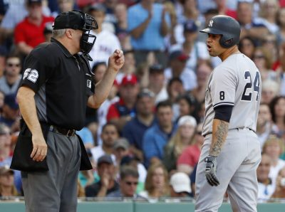 Sep 17, 2016; Boston, MA, USA; New York Yankees catcher Gary Sanchez (24) turns to talk with home plate umpire Bill Welke (52) after being called out on strikes during the seventh inning against the Boston Red Sox at Fenway Park. Mandatory Credit: Winslow Townson-USA TODAY Sports