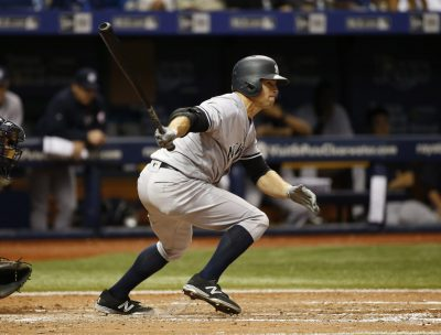 Sep 20, 2016; St. Petersburg, FL, USA; New York Yankees left fielder Brett Gardner (11) hits a RBI single during the seventh inning against the Tampa Bay Rays at Tropicana Field. Mandatory Credit: Kim Klement-USA TODAY Sports