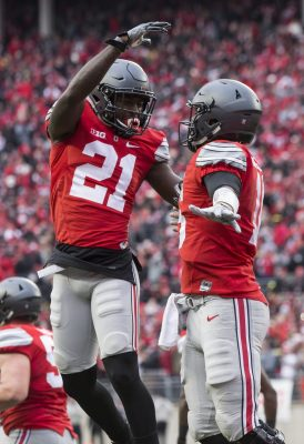 Nov 26, 2016; Columbus, OH, USA; Ohio State Buckeyes wide receiver Parris Campbell (21) congratulates Ohio State Buckeyes quarterback J.T. Barrett (16) on his touchdown against the Michigan Wolverines at Ohio Stadium. Ohio State won the game 30-27 in double overtime. Mandatory Credit: Greg Bartram-USA TODAY Sports