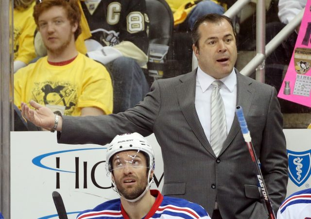 Apr 16, 2016; Pittsburgh, PA, USA; New York Rangers head coach Alain Vigneault gestures behind the bench against the Pittsburgh Penguins in game two of the first round of the 2016 Stanley Cup Playoffs at the CONSOL Energy Center. The Rangers won 4-2 to even the series. Mandatory Credit: Charles LeClaire-USA TODAY Sports