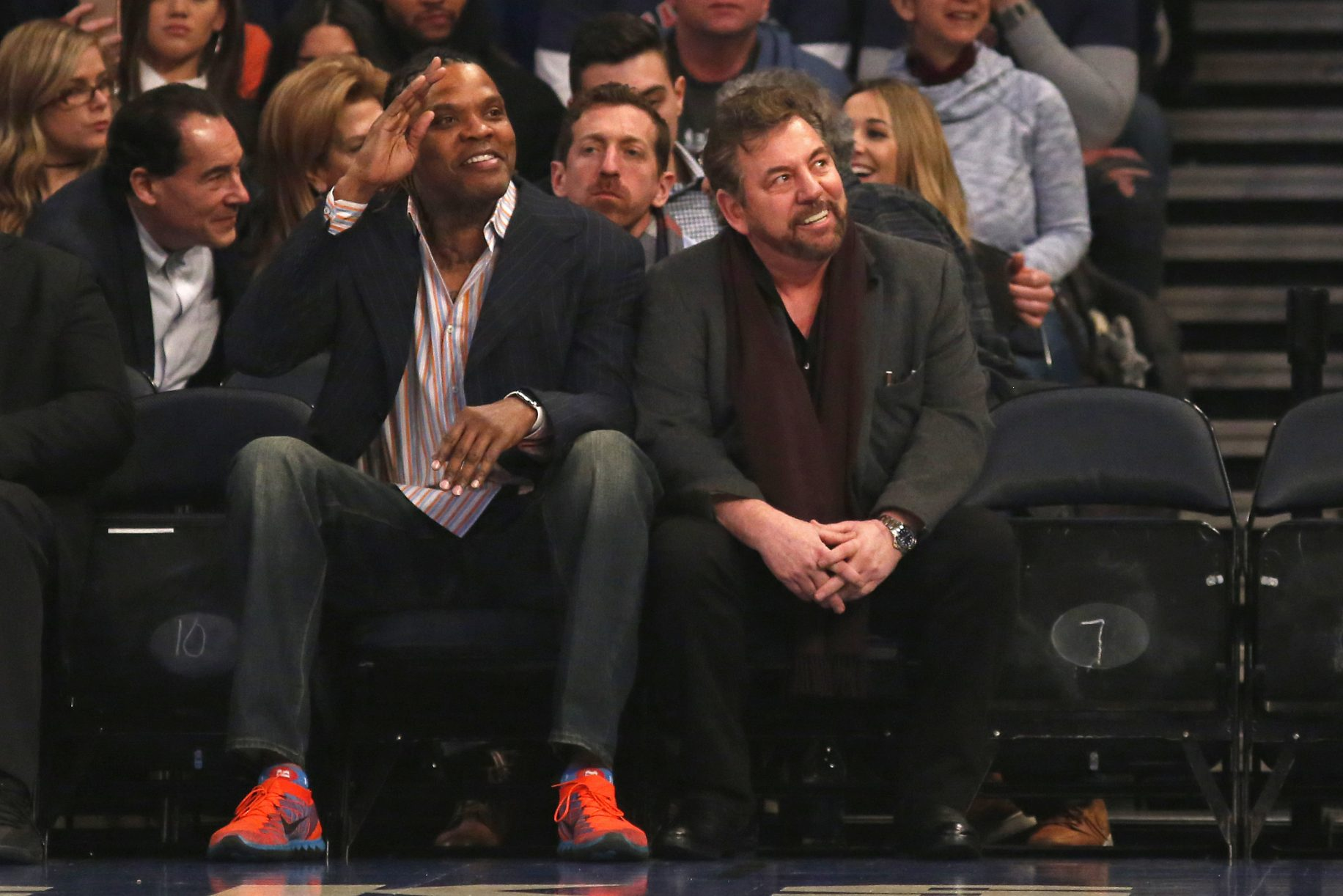 James Dolan slaps Charles Oakley in the face by sitting next to Latrell Sprewell