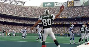 20 Sep 1998: Wide Receiver Wayne Chrebet #80 of the New York Jets celebrates in the end-zone after making a touchdown, during the game against the Indianapolis Colts at Giant Stadium in East Rutherford, New Jersey. The Jets defeated Colts 44-6. Mandato