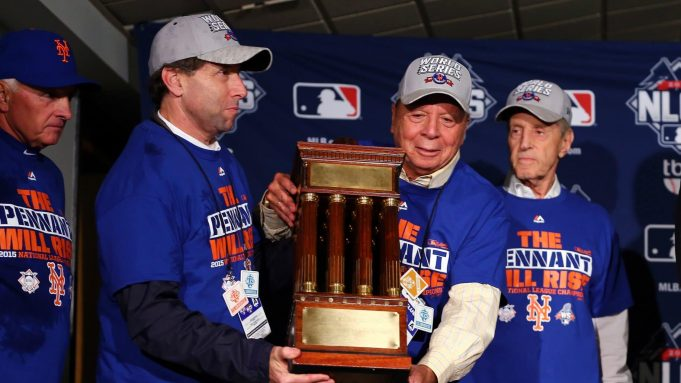 CHICAGO, IL - OCTOBER 21: (L-R) Chief Operating Officer Jeff Wilpon, Chief Executive Officer Saul Katz and Owner Fred Wilpon of the New York Mets pose with the NLCS trophy after defeating the Chicago Cubs in game four of the 2015 MLB National League Championship Series at Wrigley Field on October 21, 2015 in Chicago, Illinois. The Mets defeated the Cubs with a score of 8 to 3 to sweep the Championship Series.