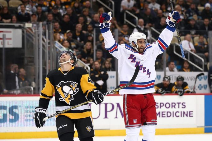 Benoit Pouliot, Marc Staal and Derick Brassard of the New York Rangers  celebrate after Brassard