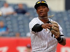 The New York Yankees have sent third base prospect Miguel Andujar to Triple-A, while outfielder Estevan Florial heads to their minor league camp.